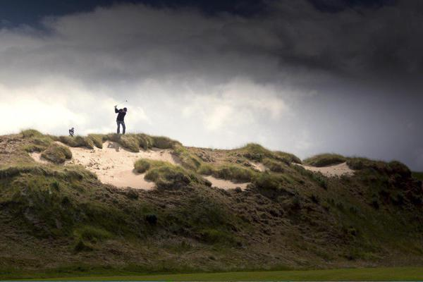Tom on top of the world at Castle Stuart GL. Image credit Recounter