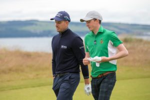Ru walking the fairways of Castle Stuart with Henrik Stenson. Image: Kenny Smith
